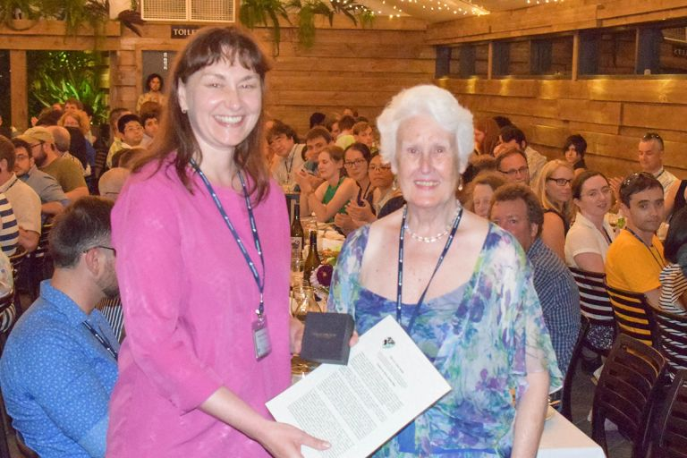 Kate Smith-Miles (left) receives award from Helen Tuck, wife of EO Tuck